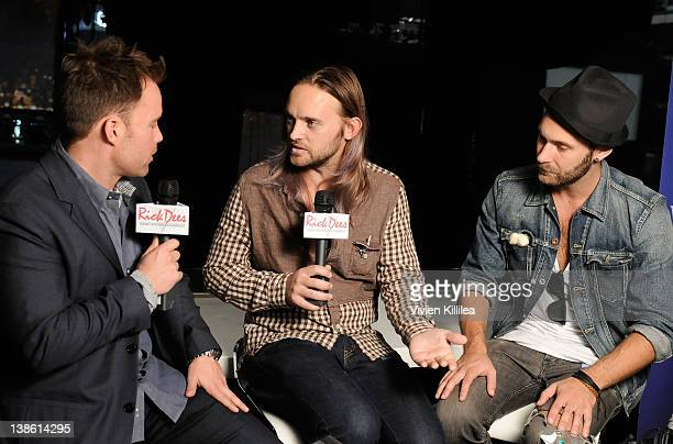 Musicians Chad Wolf and Rickard Goransson of Carolina Liar interview backstage at the GRAMMYs Dial Global Radio Remotes during The 54th Annual GRAMMY...