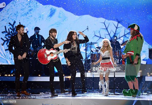 Musicians Charles Kelley Dave Haywood Hillary Scott of Lady Antebellum with hosts Kristin Chenoweth and Trace Adkins perform onstage during the 2012...