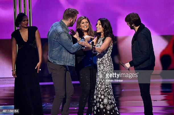 Musicians Charles Kelley Hilary Scott and Dave Haywood of Lady Antebellum accept the award for Favorite Country Group onstage with actress Lisa...