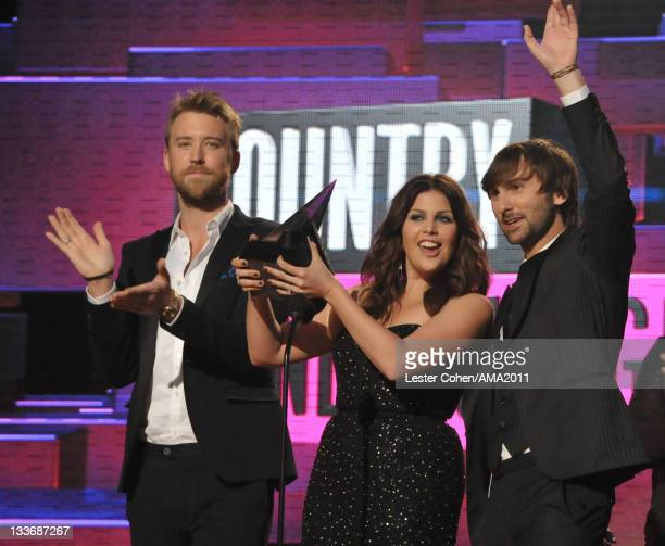 Musicians Charles Kelley, Hillary Scott and Dave Haywood of Lady Antebellum onstage at the 2011 American Music Awards held at Nokia Theatre L.A. LIVE...