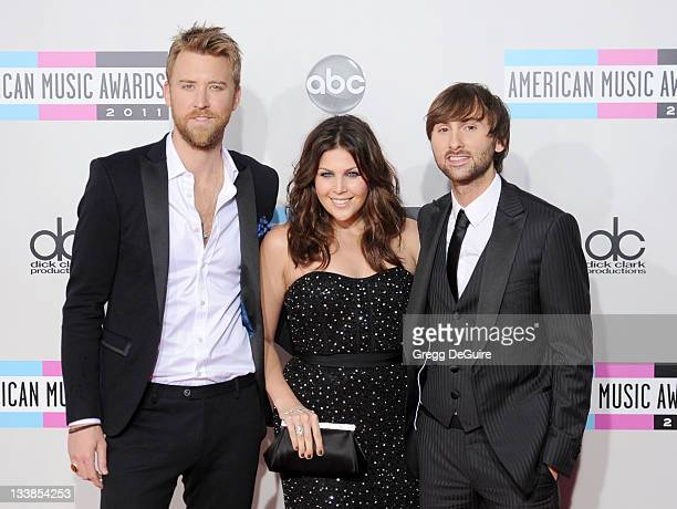 Musicians Charles Kelley, Hillary Scott and Dave Haywood of Lady Antebellum arrive at the 2011 American Music Awards at Nokia Theatre L.A. Live on...
