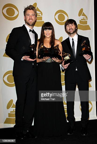 Musicians Charles Kelley Hillary Scott and Dave Haywood of Lady Antebellum pose in the press room at The 53rd Annual GRAMMY Awards held at Staples...