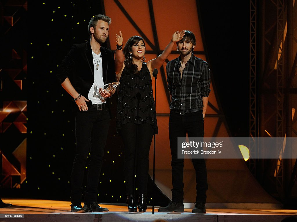 Musicians Charles Kelley, Hillary Scott and Dave Haywood of Lady Antebellum during the 45th annual CMA Awards at the Bridgestone Arena on November 9, 2011 in Nashville, Tennessee.
