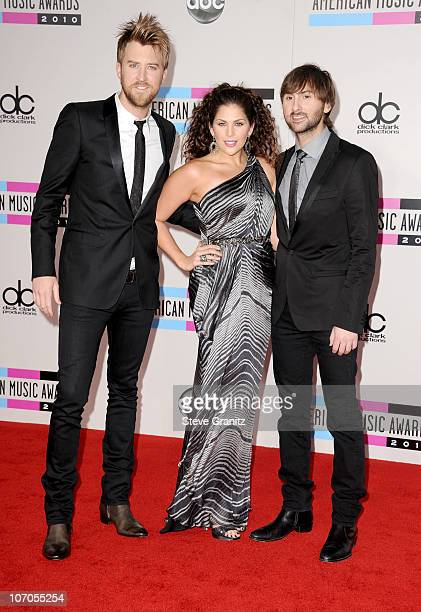 Musicians Charles Kelley Hillary Scott and Dave Haywood of the band Lady Antebellum arrive at the 2010 American Music Awards held at Nokia Theatre LA...