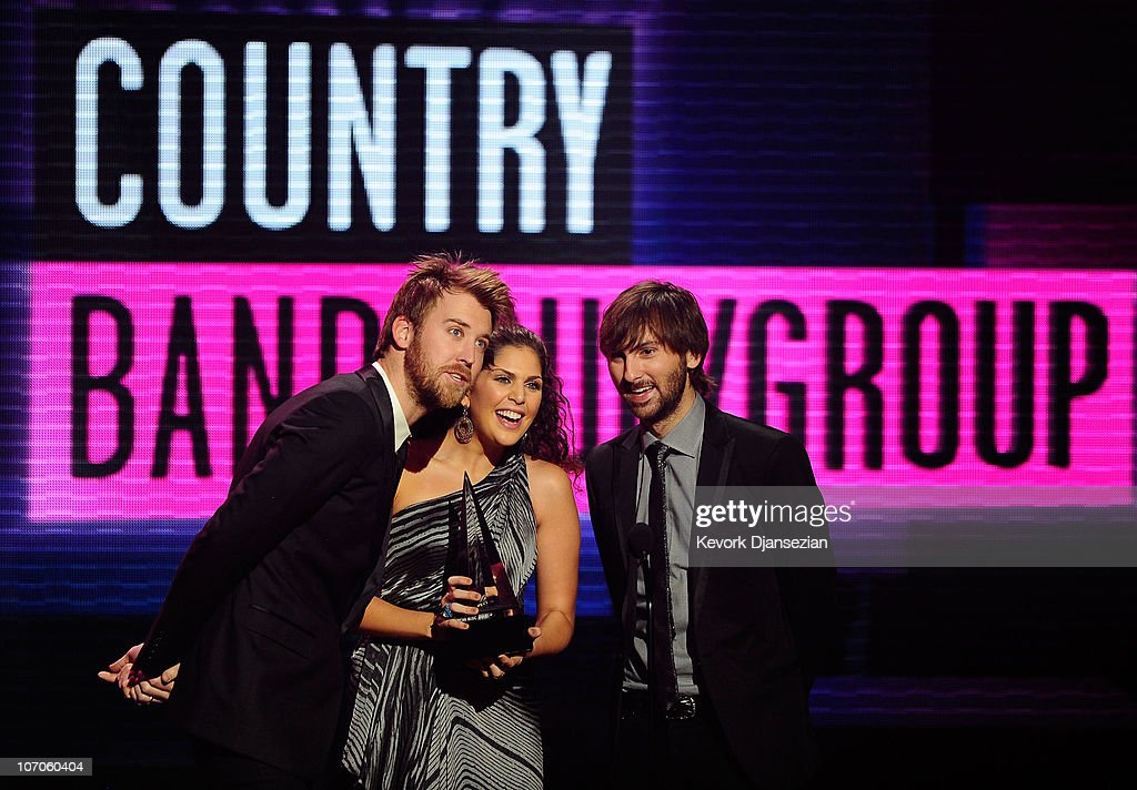 Musicians Charles Kelley, Hillary Scott and Dave Haywood of the band Lady Antebellum present onstage during the 2010 American Music Awards held at Nokia Theatre L.A. Live on November 21, 2010 in Los Angeles, California.