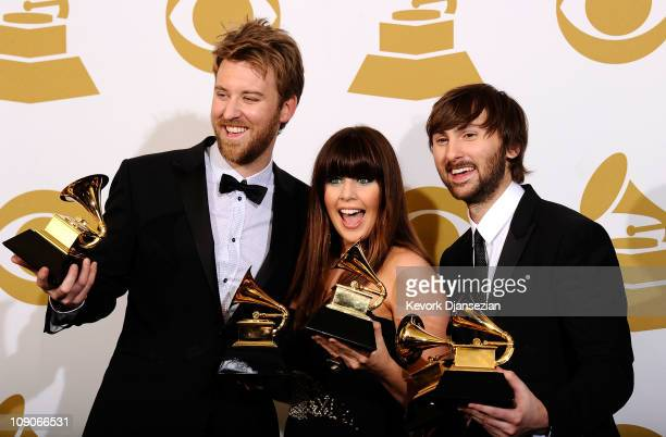 Musicians Charles Kelley Hillary Scott and Dave Haywood of the band Lady Antebellum winners of several Grammy Awards pose in the press room at The...