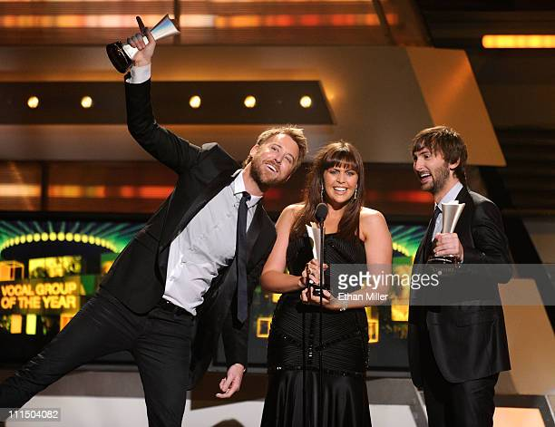 Musicians Charles Kelley Hillary Scott and Dave Haywood of the group Lady Antebellum accept the Vocal Group of the Year Award onstage at the 46th...