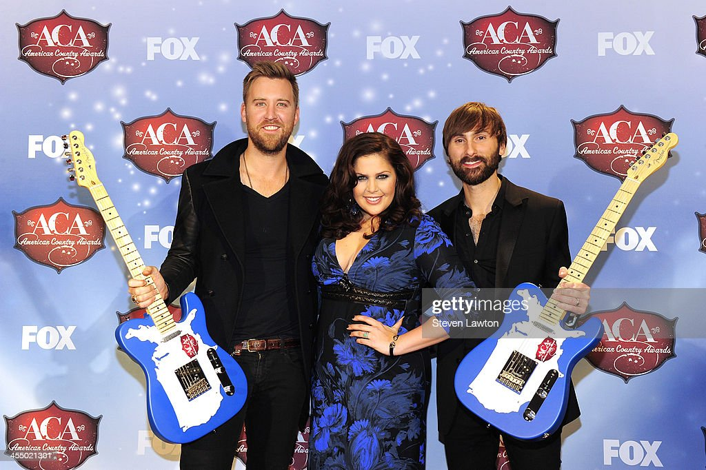 Musicians Charles Kelly, Hillary Scott and Dave Haywood of Lady Antebellum pose in th press room during the American Country Awards 2013 at the Mandalay Bay Events Center on December 10, 2013 in Las Vegas, Nevada.