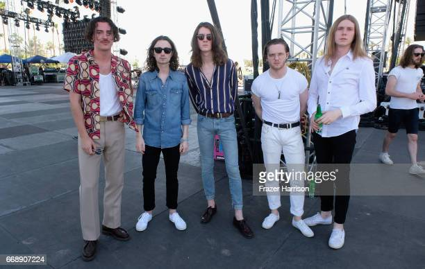 Musicians Charlie Salt Josh Dewhurst Tom Ogden Joe Donovan and Myles Kellock of Blossoms pose backstage at the Outdoor Stage during day 2 of the...