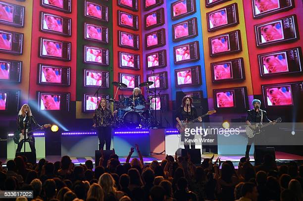 Musicians Charlotte Caffey Belinda Carlisle Gina Schock Paula Jean Brown and Jane Wiedlin of The GoGo's perform onstage during the 2016 Billboard...