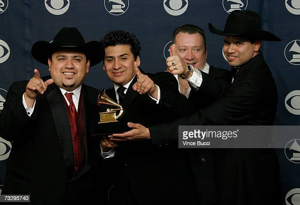 Musicians Chente Barrera Marcos Hernandez JB Hernandez and Jesse Martinez poses with their Grammy for Best Tejano Album in the press room at the 49th...