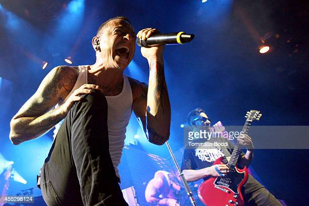 Musicians Chester Bennington and Mike Shinoda of Linkin Park perform during 'The Carnivores Tour' at Verizon Wireless Amphitheater on September 11...