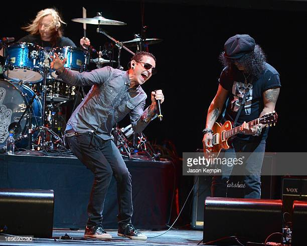 Musicians Chester Bennington and Slash perform during the 9th Annual MusiCares MAP Fund Benefit Concert at Club Nokia on May 30 2013 in Los Angeles...