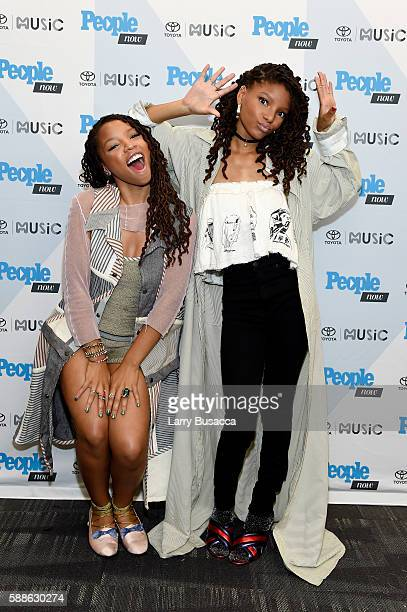 Musicians Chloe Bailey and Halle Bailey of Chloe X Halle pose backstage during the People Now Concert Series presented by Toyota Music with Chloe X...