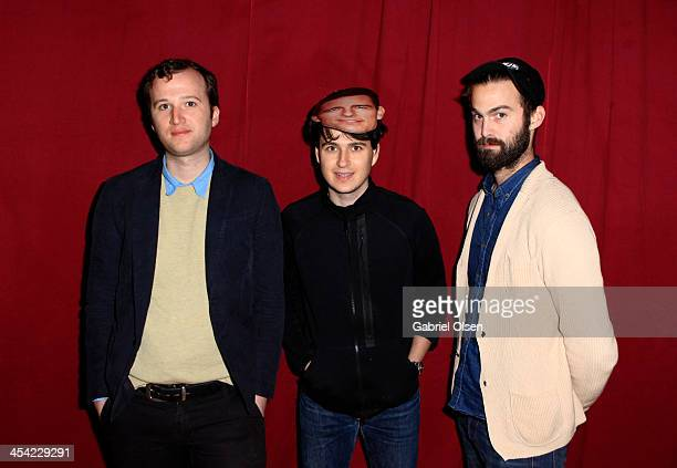 Musicians Chris Baio Ezra Koenig wearing a Tom Cruise mask and Chris Tomson of Vampire Weekend pose backstage during The 24th Annual KROQ Almost...