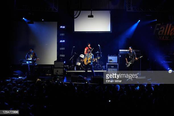 Musicians Chris Baio Rostam Batmanglij Chris Tomson and Ezra Koenig of Vampire Weekend perform onstage during the Fallout New Vegas launch event...