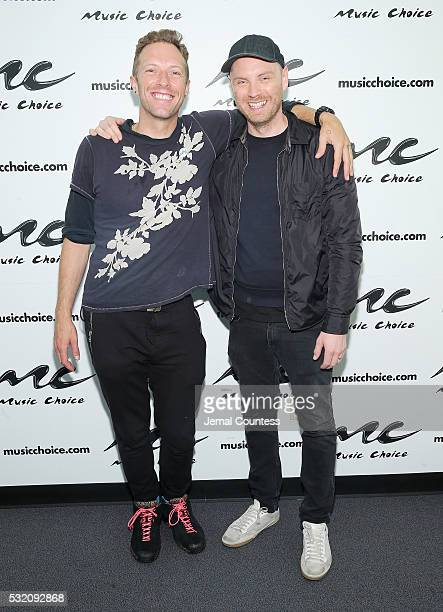 Musicians Chris Martin and Jonny Buckland of the band Coldplay pose for a photo during a visit to Music Choice at Music Choice on May 18 2016 in New...