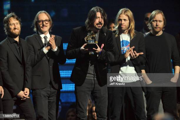 Musicians Chris Shiflett Butch Vig Dave Grohl Taylor Hawkins and Nate Mendel onstage at the 54th Annual GRAMMY Awards held at Staples Center on...