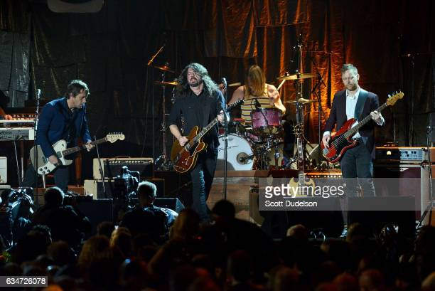 Musicians Chris Shiflett Dave Grohl and Taylor Hawkins and Nate Mendel of The Foo Fighters perform onstage during the 2017 MusiCares Person of the...