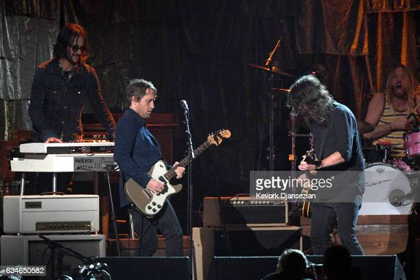 Musicians Chris Shiflett Dave Grohl and Taylor Hawkins of Foo Fighters perform onstage during MusiCares Person of the Year honoring Tom Petty at the...