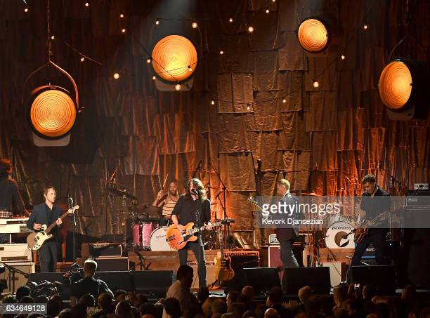 Musicians Chris Shiflett Dave Grohl Nate Mendel and Pat Smear of Foo Fighters perform onstage during MusiCares Person of the Year honoring Tom Petty...