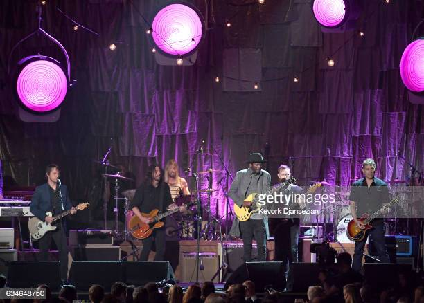 Musicians Chris Shiflett Dave Grohl of Foo Fighters Gary Clark Jr Nate Mendel and Pat Smear of Foo Fighters perform onstage during MusiCares Person...