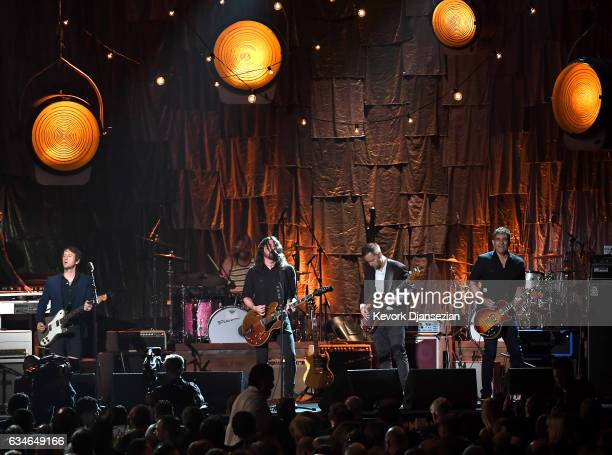Musicians Chris Shiflett Taylor Hawkins Dave Grohl Nate Mendel and Pat Smear of Foo Fighters perform onstage during MusiCares Person of the Year...