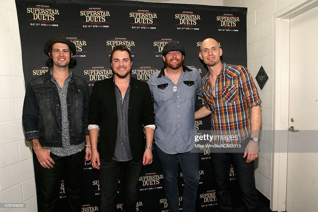 Musicians Chris Thompson, Mike Eli, James Young and Jon Jones of the Eli Young Band attend ACM Presents: Superstar Duets at Globe Life Park in Arlington on April 17, 2015 in Arlington, Texas.