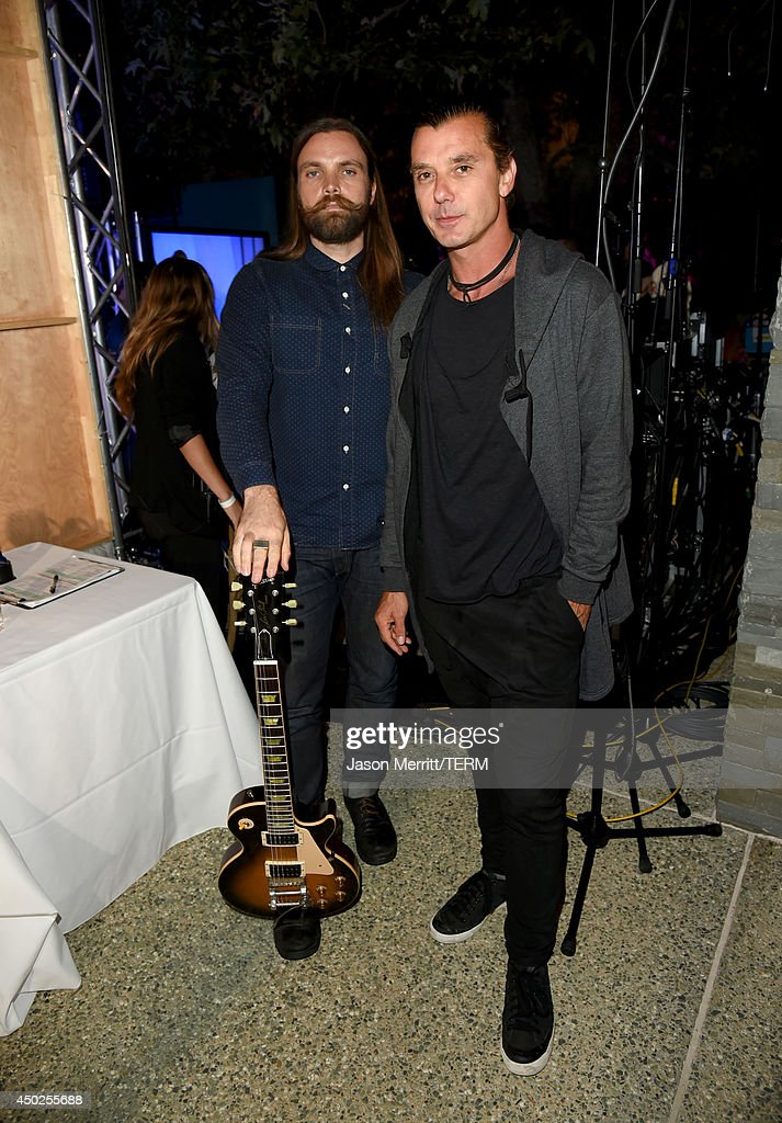 Musicians Chris Traynor (L) and Gavin Rossdale inside the 13th Annual Chrysalis Butterfly Ball sponsored by Audi, Kayne Anderson and Stella Artois in Los Angeles, California on June 7th, 2014.