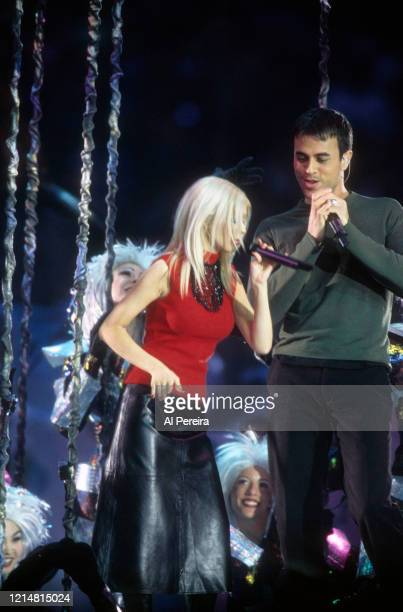"""Musicians Christina Aguilera and Enrique Iglesias perform as part of the """"A Tapestry Of Nations"""" Halftim Show of Super Bowl XXXIII on January 30,..."""
