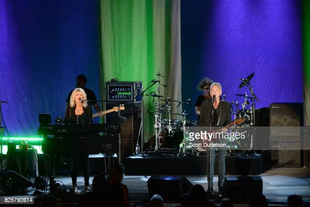 Musicians Christine McVie and Lindsey Buckingham of Fleetwood Mac perform onstage at The Greek Theatre on August 2 2017 in Los Angeles California