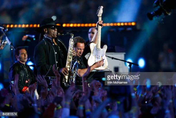 Musicians Clarence Clemons and Bruce Springsteen of the E Street Band perform at the Bridgestone halftime show during Super Bowl XLIII between the...