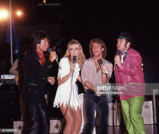 Musicians Cliff Richard Olivia NewtonJohn Andy Gibb and Elton John perform on the 'Hollywood Nights' TV special in March 1980 in Los Angeles...