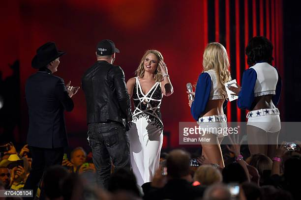 Musicians Clint Black Brantley Gilbert present honoree Miranda Lambert with the award for Album of the Year for Platinum onstage during the 50th...