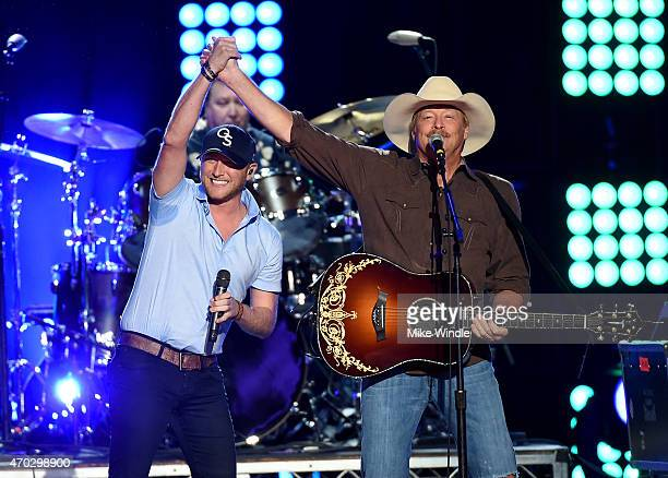 Musicians Cole Swindell and Alan Jackson perform onstage during ACM Presents Superstar Duets at Globe Life Park in Arlington on April 18 2015 in...