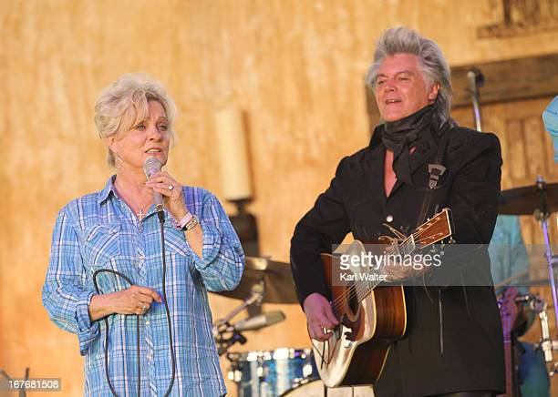 Musicians Connie Smith and Marty Stuart perform onstage during 2013 Stagecoach California's Country Music Festival held at The Empire Polo Club on...