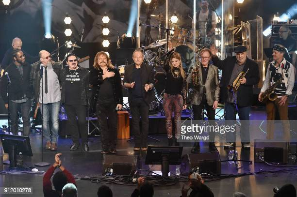 Musicians Cory Henry Chris Thompson Bobby Kimball Leslie Mandoki Nick Van Eede Julia Mandoki John Helliwell Randy Brecker and Bill Evans pose onstage...