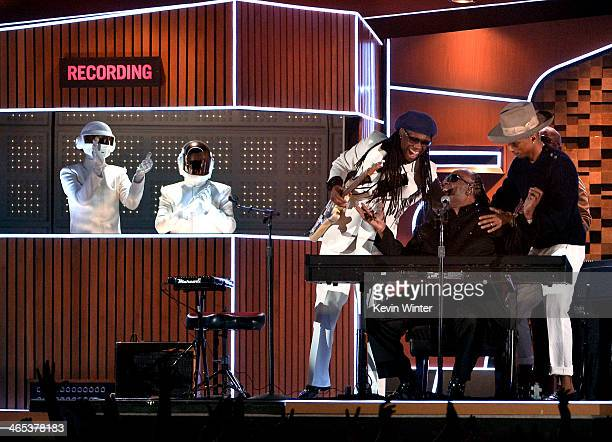 Musicians Daft Punk Nile Rodgers Stevie Wonder and Pharrell Williams perform onstage during the 56th GRAMMY Awards at Staples Center on January 26...
