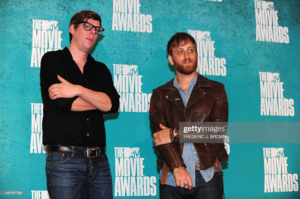 Musicians Dan Auerbach (R) and Patrick Carney of The Black Keys pose in the press room at the MTV Movie Awards at Universal Studios, in Los Angeles, California, on June 3, 2012.