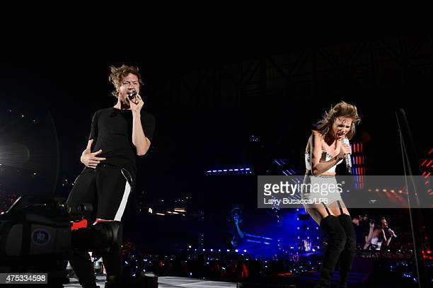 Musicians Dan Reynolds of Imagine Dragons and Taylor Swift perform on stage during the 1989 World Tour Live at Ford Field on May 30 2015 in Detroit...