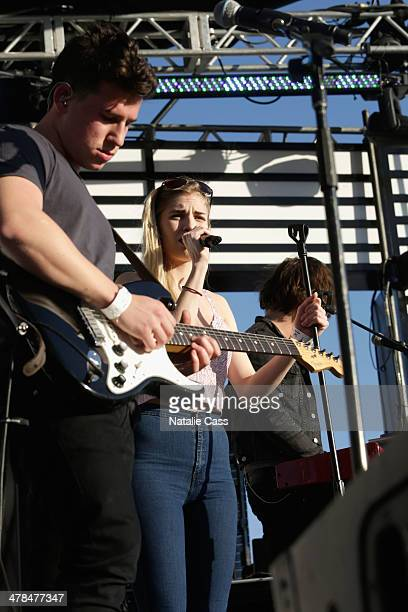 Musicians Dan Rothman and Hannah Reid of London Grammar perform onstage at the 2014 mtvU Woodie Awards and Festival on March 13 2014 in Austin Texas