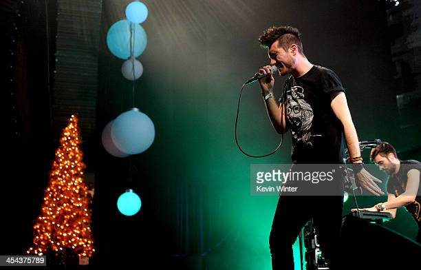 Musicians Dan Smith and Kyle Jonathan Simmons of Bastille perform onstage during The 24th Annual KROQ Almost Acoustic Christmas at The Shrine...
