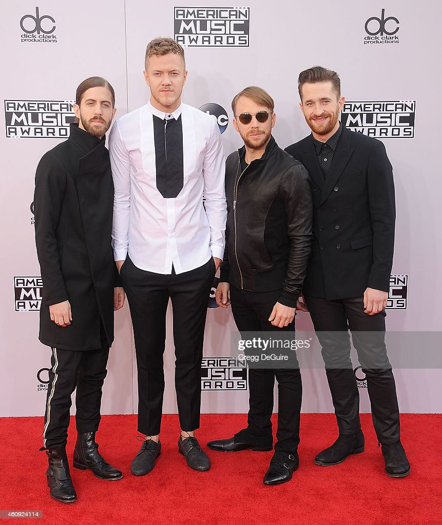 Musicians Daniel Wayne Sermon, Dan Reynolds, Ben McKee and Daniel Platzman of Imagine Dragons arrive at the 2014 American Music Awards at Nokia Theatre L.A. Live on November 23, 2014 in Los Angeles, California.