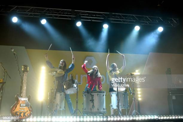 Musicians Danielle Haim Alana Haim and Este Haim of HAIM perform onstage during Bumble Presents Empowering Connections at Fair Market on March 10...