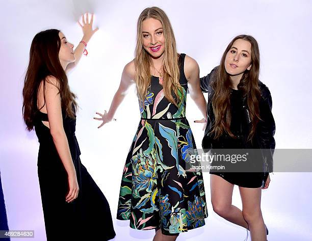 Musicians Danielle Haim Este Haim and Alana Haim attend the HM Loves Coachella Tent at the 2015 Coachella Valley Music Arts Festival at the Empire...