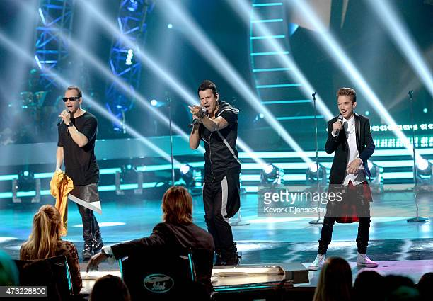 Musicians Danny Wood and Jordan Knight of NKOT and finalist Daniel Seavey perform onstage during American Idol XIV Grand Finale at Dolby Theatre on...