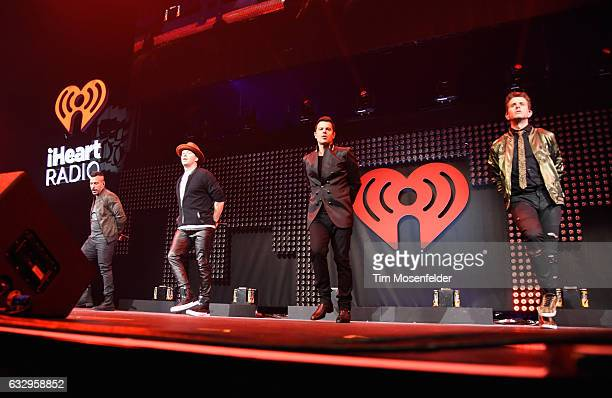 Musicians Danny Wood Donnie Wahlberg Jordan Knight and Joey McIntyre of New Kids on the Block perform on stage during the iHeart80s Party 2017 at SAP...