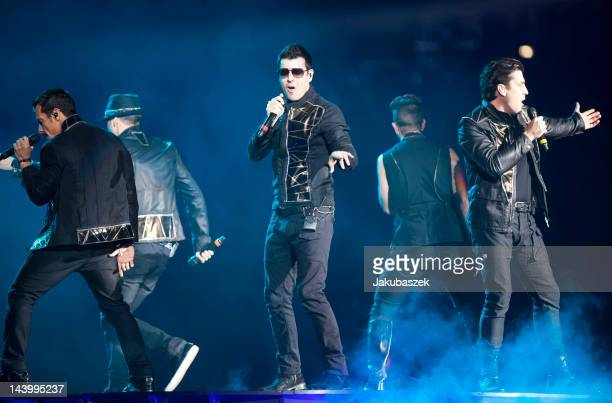 Musicians Danny Wood Jordan Knight and Jonathan Knight of the band New Kids on the Block perform live during te NKOTBSB Tour concert at the O2 World...