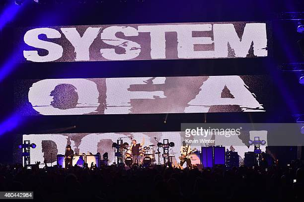 Musicians Daron Malakian Serj Tankian John Dolmayan and Shavo Odadjian of System of a Down perform onstage during day one of the 25th annual KROQ...