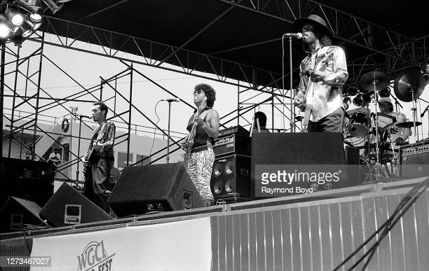 Musicians Darwin Dortch, Leroy 'Sugarfoot' Bonner and Clarence 'Chet' Willis of The Ohio Players performs during the 'WGCI-FM Power Fest '88' at Navy...